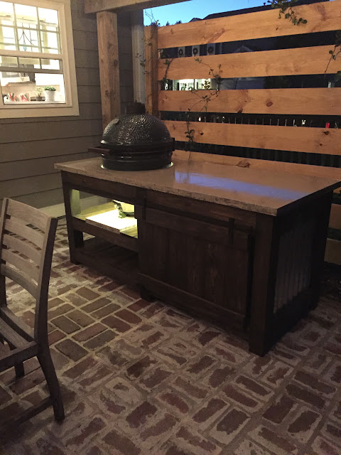 The perfect Big Green Egg table with concrete top, barn door, and built in lights | The Lowcountry Lady