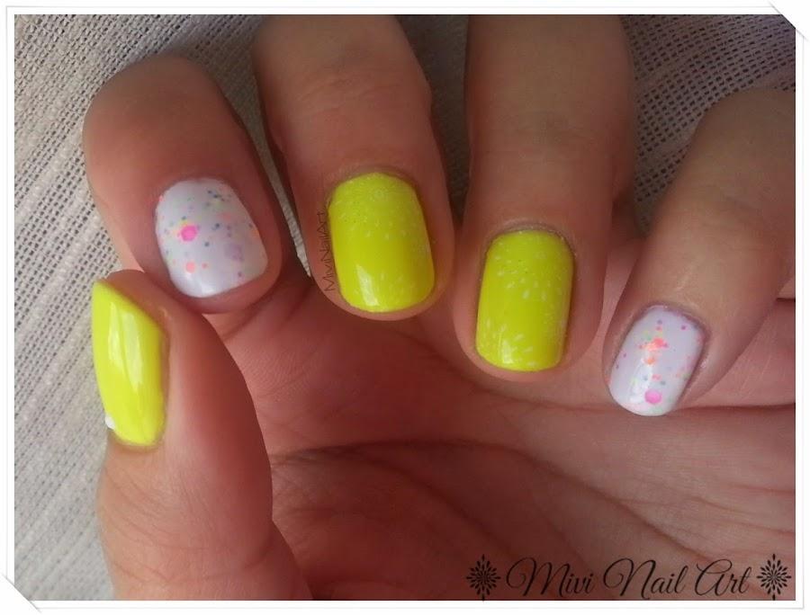 http://mivinailart.blogspot.com.es/2014/06/manicura-amarillo-neon-mas-glitter-neon.html