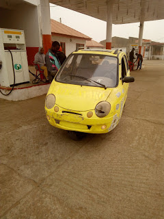 See the three wheel circle 'Keke Napep' designed like a sport car with two doors
