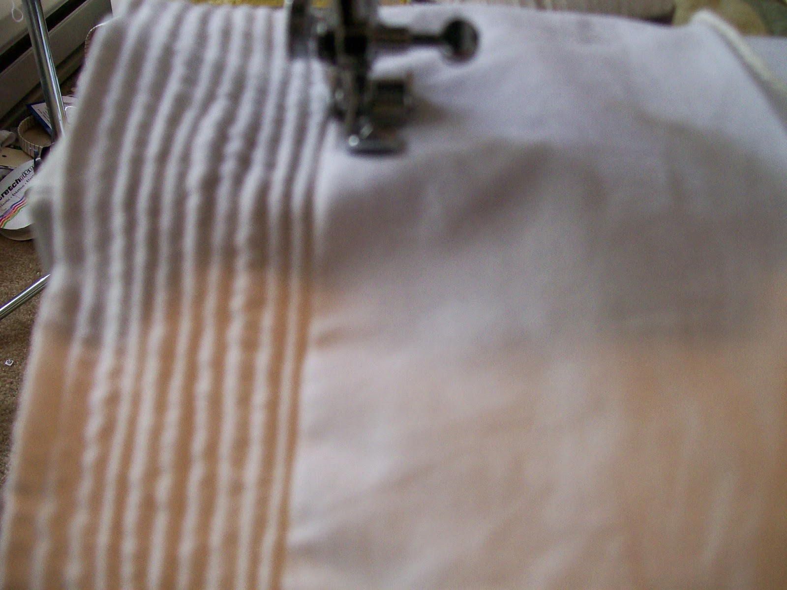 Cording petticoat on sewing machine with zipper foot.