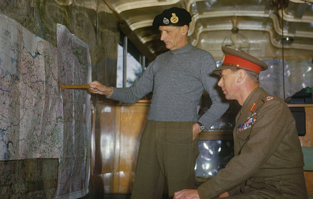Field Marshal Sir Bernard Montgomery pointing out the German West Wall region to King George VI  color photos of World War II worldwartwo.filminspector.com