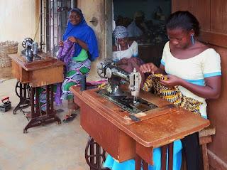 Seamstresses at work at Djamina Couture in Lome Togo
