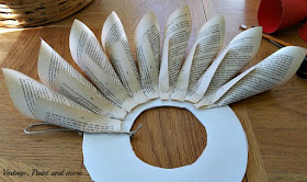 Vintage, Paint and more... partially completed first row of cones attached to base for a book page wreath