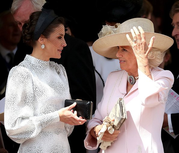 The Duchess is wearing Catherine Walker. Queen Maxima is wearing Claes Iversen. Queen Letizia wore a printed midi dress by Cherubina