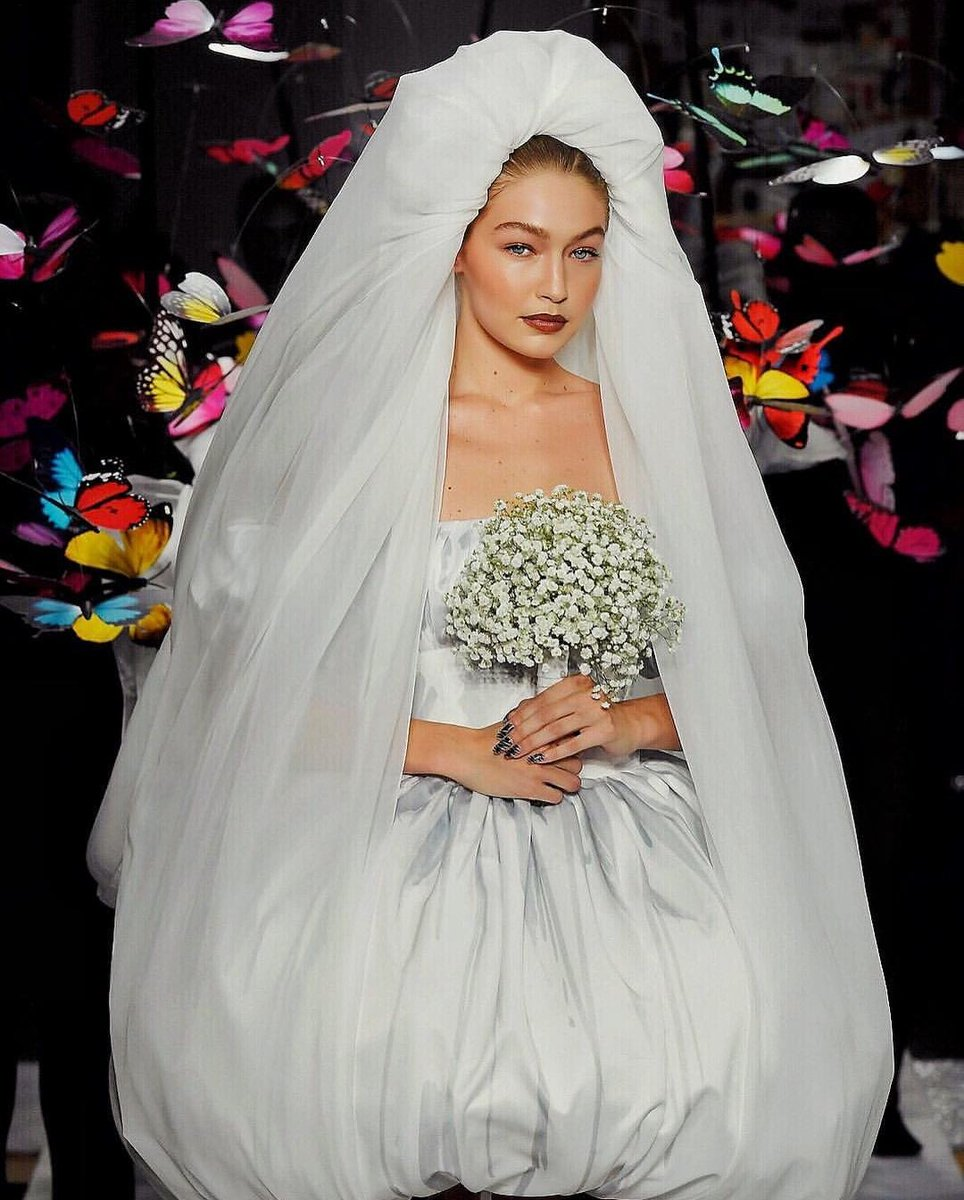 Gigi Hadid Closed the Moschino Show in a Giant Wedding Veil 'Carried' by Butterflies