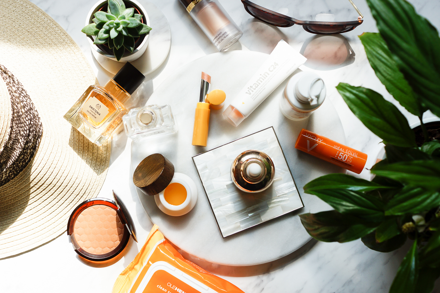 glowing-summer-skin-favourites-flatlay-photography-barely-there-beauty-blog