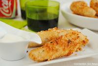 Bastones de pollo rebozadas con parmesano y romero