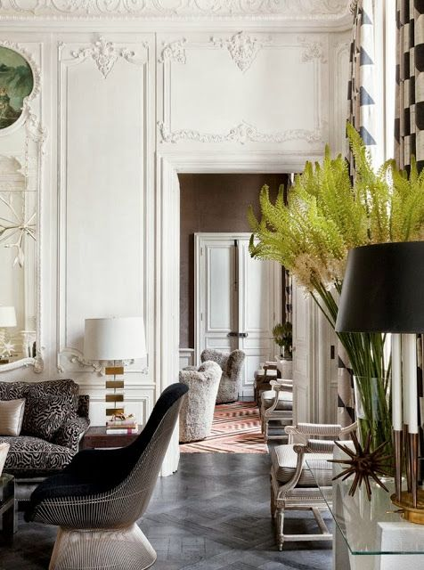 Besides The White Paint Gives Clically Inspired Interiors Of Paris Apartment A Modern Casual Ambiance And Light Airy Feel