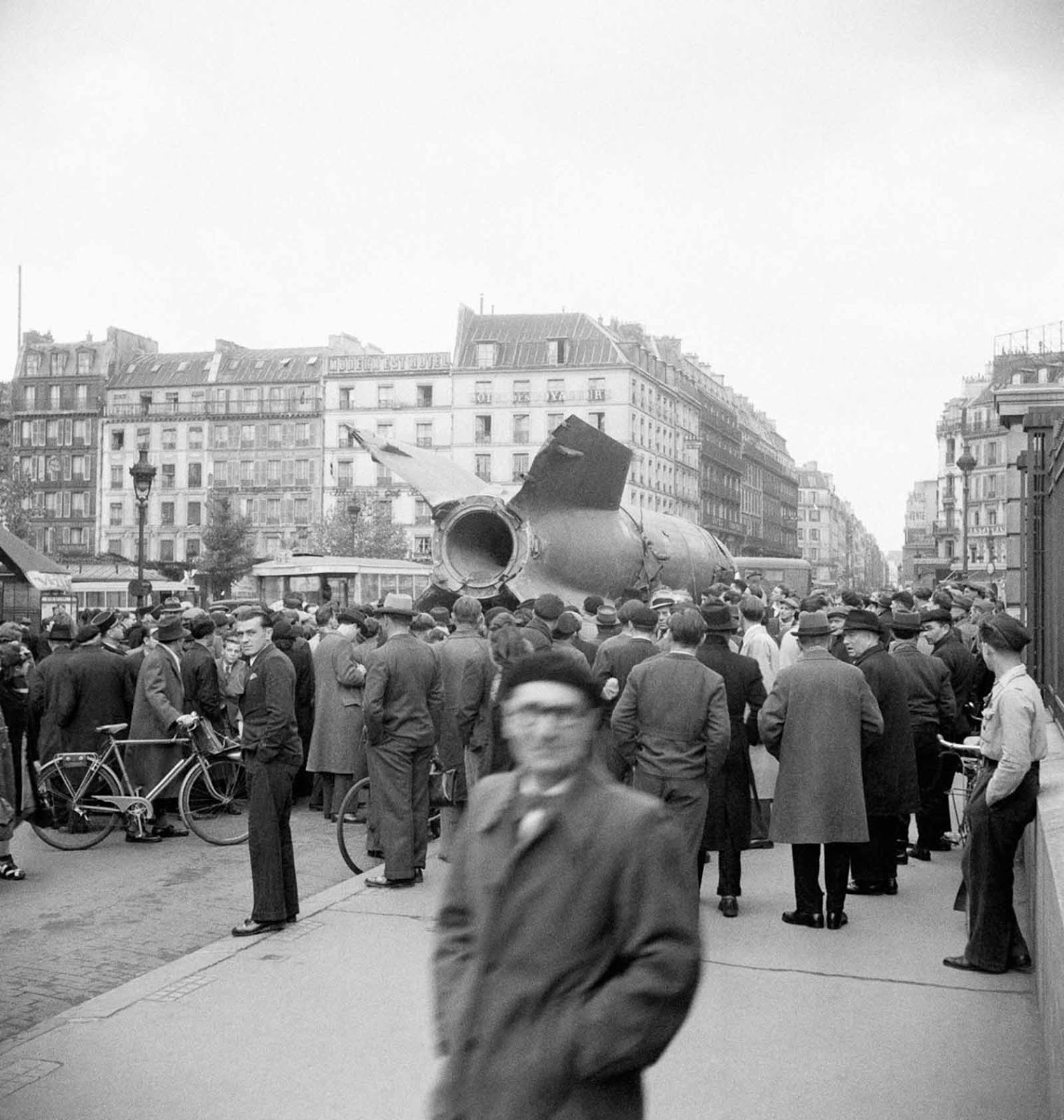A captured V-2 is paraded through Paris. 1945.