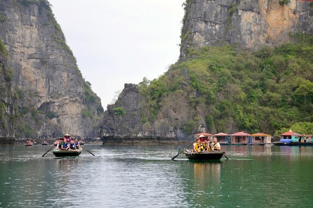 Visit Halong bay by bamboo boats 1
