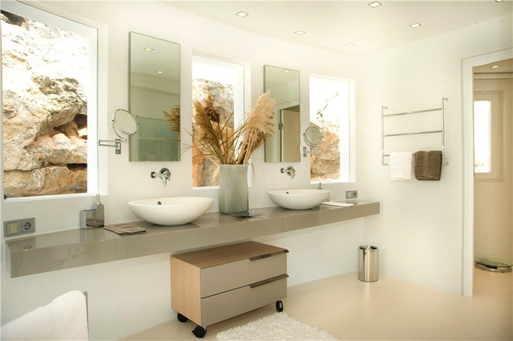 Two sink bathroom in Mediterranean villa in Mallorca by Alberto Rubio