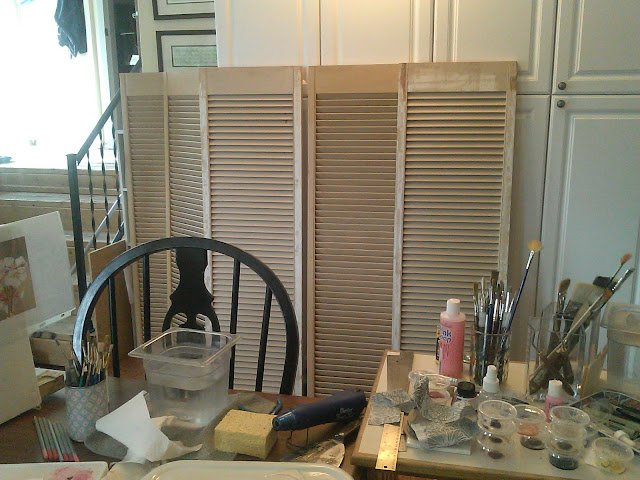 Shutters purchased at a yard sale will become my display panels for framed artwork.