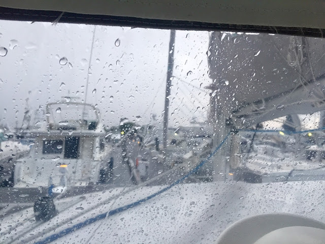 Rain on the dodger on our Lagoon 380 sail catamaran