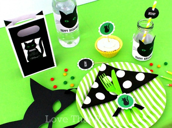 image of kids Halloween party table with black and green, black cats, cats eyes