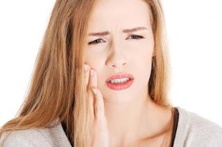 Trám răng xong bị đau nhức