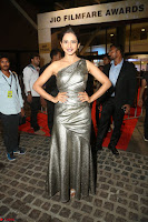 Rakul Preet Singh in Shining Glittering Golden Half Shoulder Gown at 64th Jio Filmfare Awards South ~  Exclusive 055.JPG