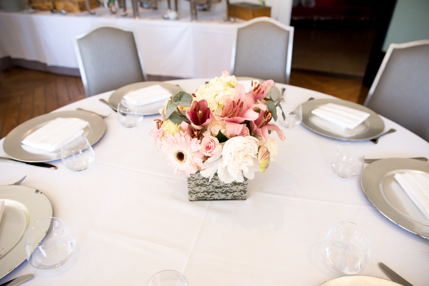 pink and white floral arrangements baby shower