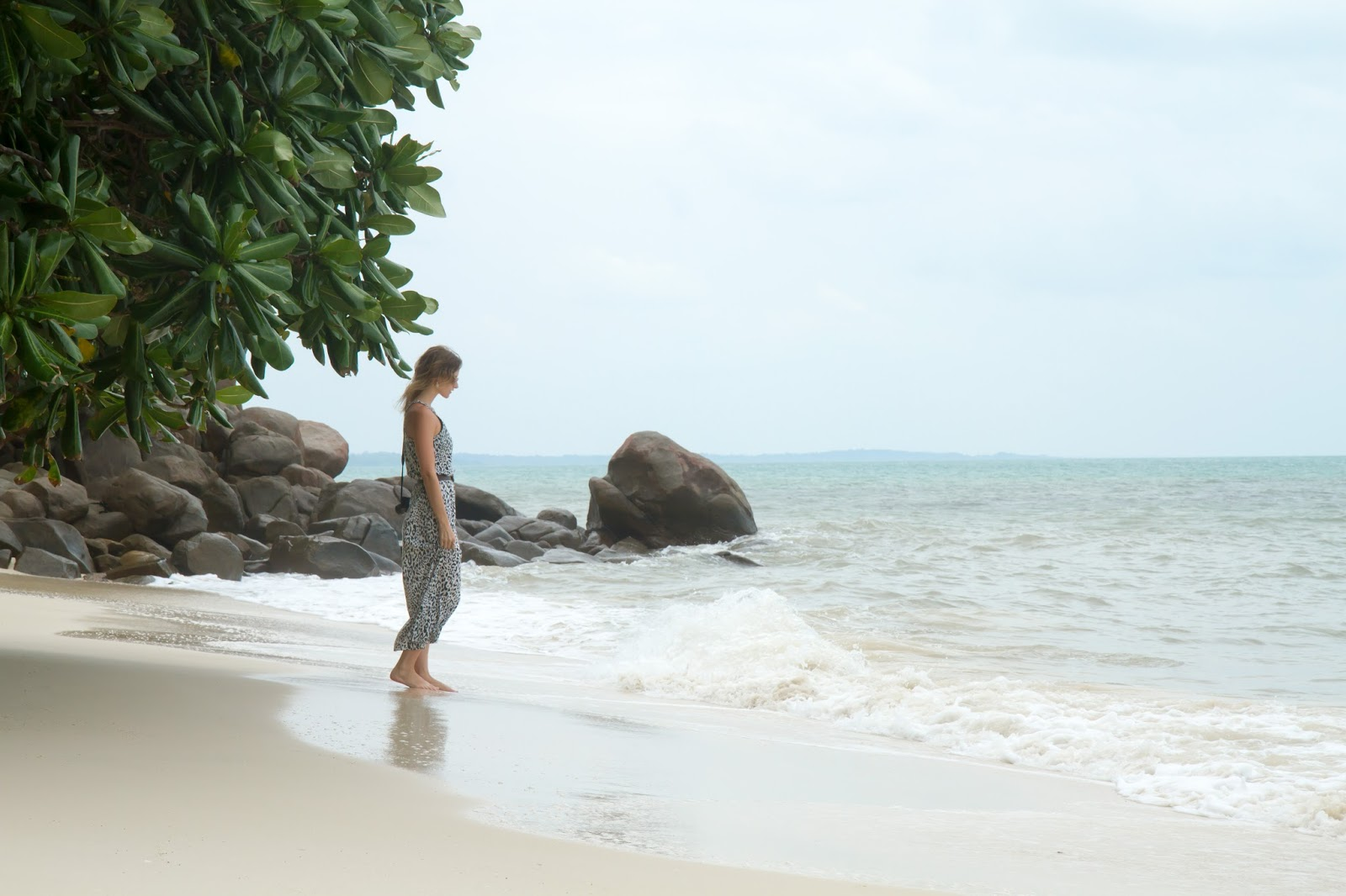 travel blogger, Alison Hutchinson, on a white sandy beach in belitunga