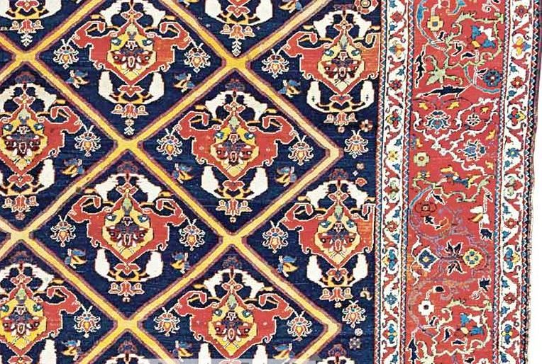 A LARGE BAKHTIARI CARPET WEST PERSIA, CIRCA 1900. Localised Wear, Scattered  Small Repairs And Repiling, Localised Light Stains, Selvages Partially  Frayed