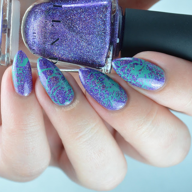 purple holographic nail polish with flower nail art