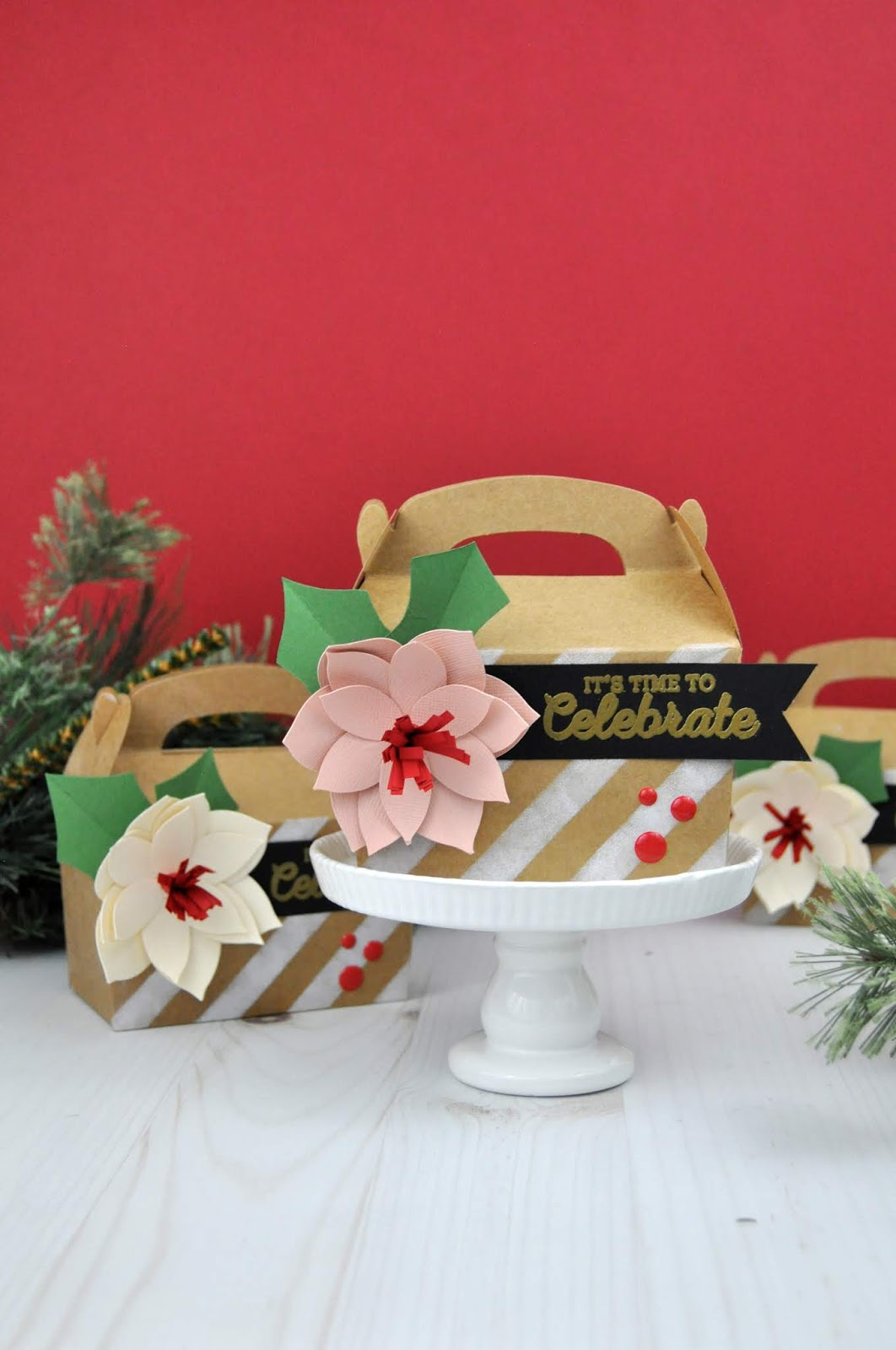 Christmas Gift Boxes with 3D Poinsettia Paper Flowers. Jen Gallacher uses boxes from JoAnn and die cut shapes from Silhouette to create this Christmas craft. #christmascraft #papercrafter #silhouette #jengallacher