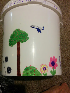 Sharpie drawing of Nature and Airplane on Guides Camp Bucket