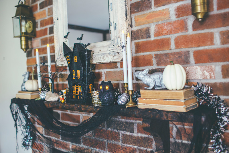 decorated fireplace mantel with whimsical Halloween decor