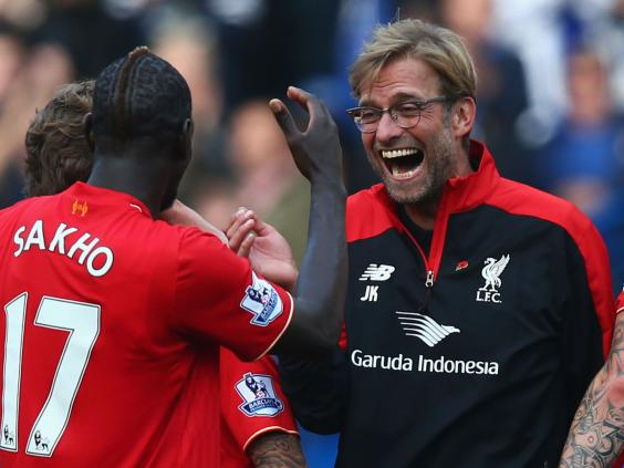 Liverpool manager Jurgen Klopp celebrates with his players after victory over Chelsea