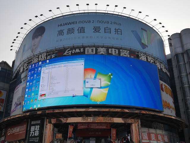 Windows desktop screen appearing on a digital billboard