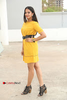 Actress Poojitha Stills in Yellow Short Dress at Darshakudu Movie Teaser Launch .COM 0046.JPG