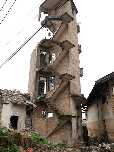 exposed stairway without railings leading up a partially demolished building