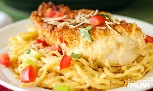 pan fried chicken breast on bed of linguine covered with creamy white wine sauce