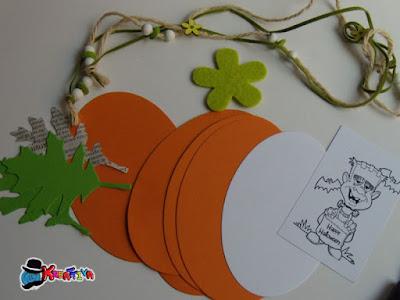 materiali necessari: ellissi di carta colla e foglie