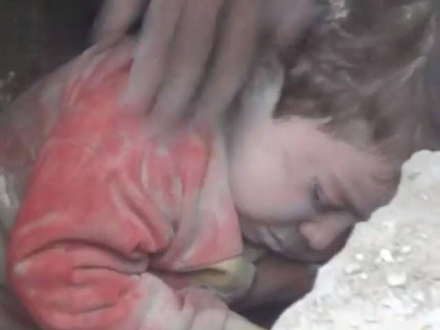 Syrian toddler miraculously survived from rubble after Aleppo bombing.