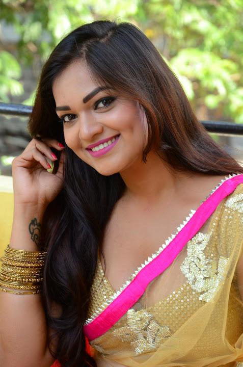 Ashwini Cleavage in Yellow Saree