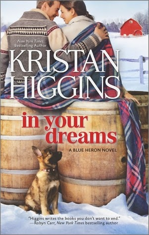 Cover description: A man and a woman sit on top of two wine barrels while a German Shepherd puppy looks up on them. The background is a winter landscape with a red barn.