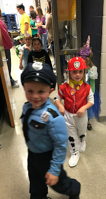 Young boy dressed as a cop