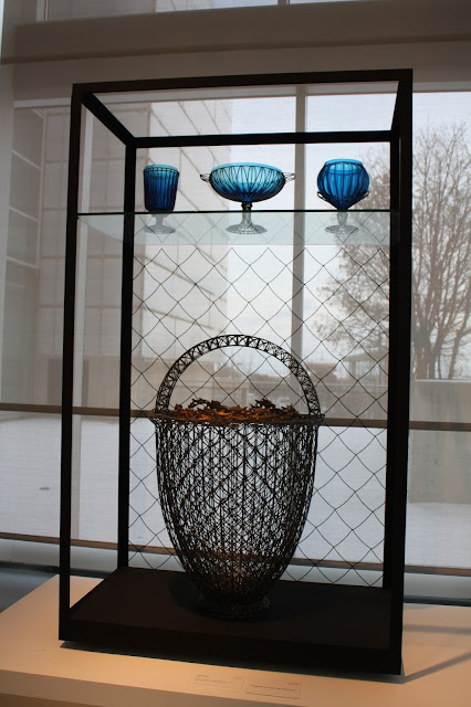 Dazzling blue glass vases catching the light at the Racine Art Museum
