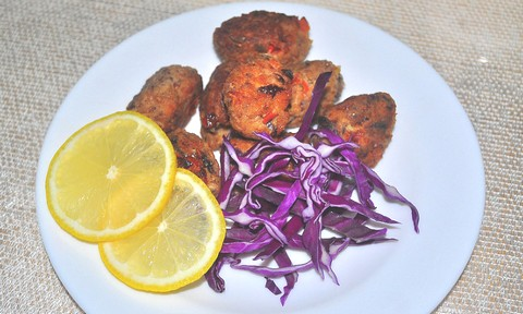 Fiery Fish Balls with Purple Cabbage and Sliced Lemon