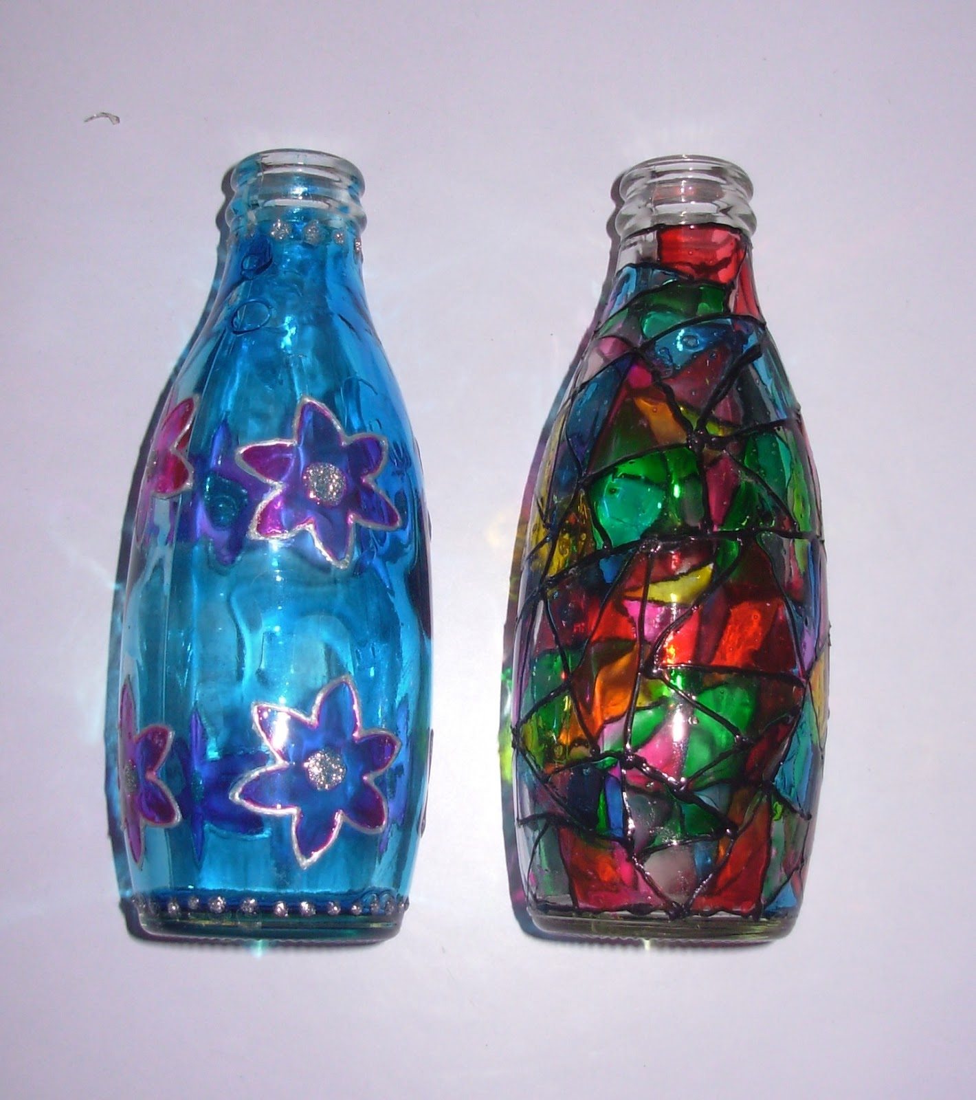 these are my painted glass bottles put some artificial flowers in it and decorate corner of your home - How To Paint Glass Bottle