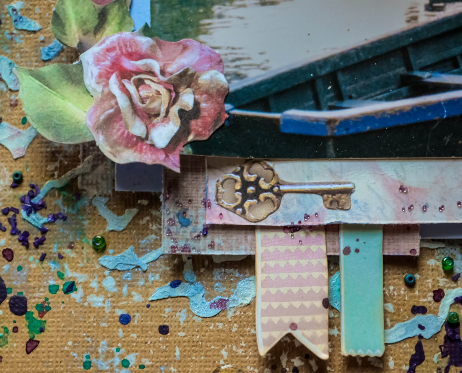 Mixed media layout on kraft background with vintage die cuts and paint splatters with seed beads, micro beads, mica flake fragments, and glass glitter