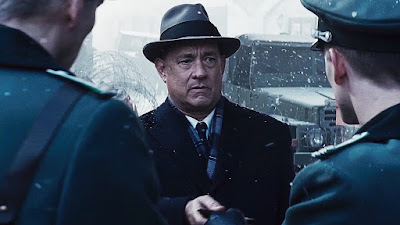 James B. Donovan gets questioned by the Stasi officers in East Berlin, in Bridge of Spies, Directed by Steven Spielberg, starring Tom Hanks