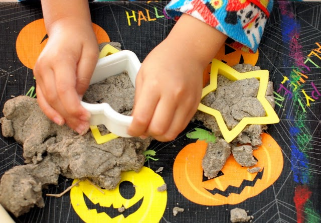 Boy playing with sand dough