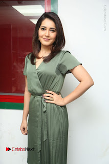 Actress Raashi Khanna Stills in Green Short Dress at Mirchi 95 Suno Aur Mercedes Jeeto Contest  0078.JPG