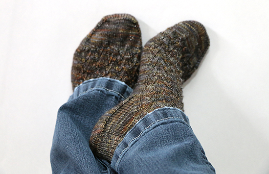 Casual Pose of Feet Wearing Hand Knit Socks