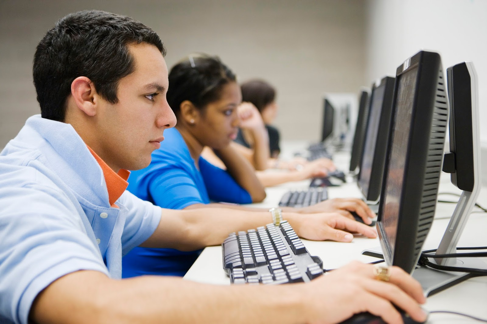 Young man in high school computer lab