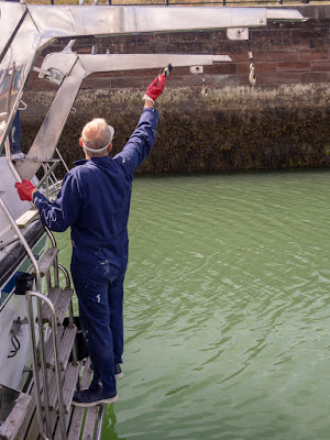 Photo of Phil cleaning the davits from the bathing platform