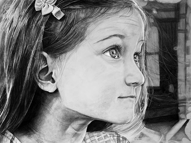 Photorealistic graphite portrait of my daughter done with graphite pencil