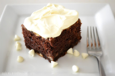 Chocolate Swirl Cake is a moist and delicious chocolate cake with swirls of a cheesecake like mixture through out and filled with white chocolate chips. Life-in-the-Lofthouse.com