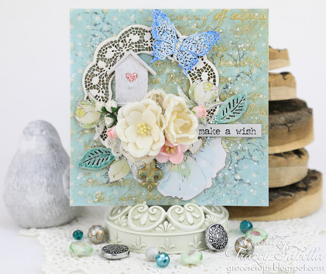 """Make a Wish"" Mixed Media Card with video tutorial by Tracey Sabella for Scrap & Craft. #shabbychic #mixedmedia #shabbychiccard #papercrafting #chipboard #usartquestprills #prills #finnabair #primamarketing #birthdaycard #finnabairproducts #handmadecard #helmar #wildorchidcrafts"